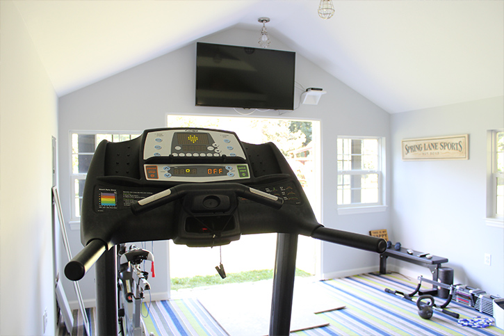 tv mounted in home gym shed